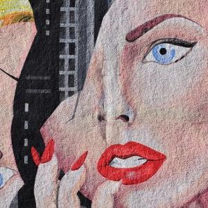 Street art of a woman's head that has been broken in two