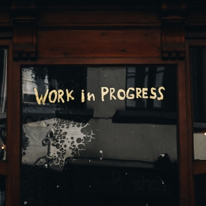 Words 'Work in progress' written on glass