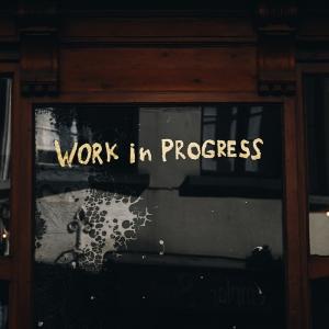 Words 'Work in progress' written on glass