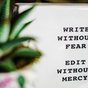 Ceramic saying 'Write without fear. Edit without mercy.'