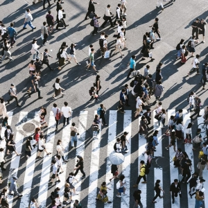 Photo of a crowd of people crossing a road