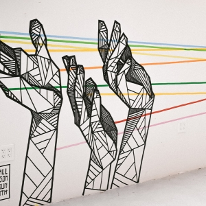 Street art of 3 hands made out of geometric shapes