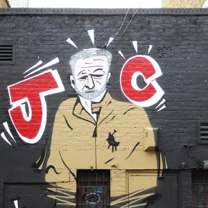 Street art of Jeremy Corbyn with the initials JC on either side