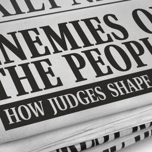 Newspaper with headline 'Enemies of the people?'