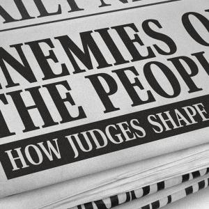 Newspaper with headline 'Enemies of the people?'