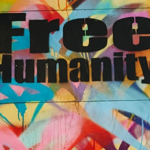 Street art saying 'Free humanity'