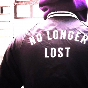Back of a jacket saying 'No longer lost'