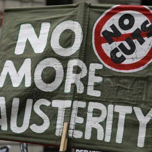 sign in protest saying 'No more austerity'