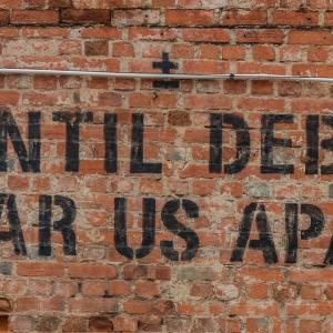 Street art saying 'Until debt tear us apart'