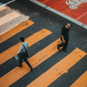 Two men walking past each other