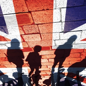 UK flag with shadows of people