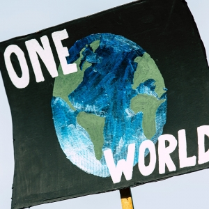 Sign saying 'One world'