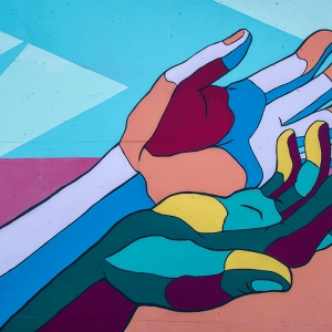 Wall art of person holding out hands