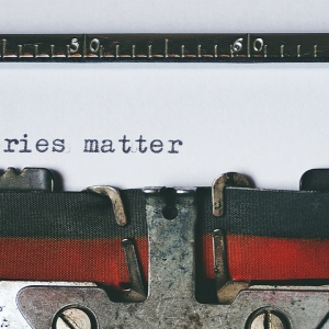 Typewriter saying 'Stories matter'
