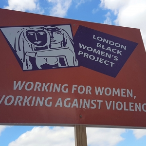 Sign saying 'Working for women, working against violence'