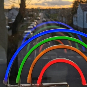 Glowstick rainbow in window