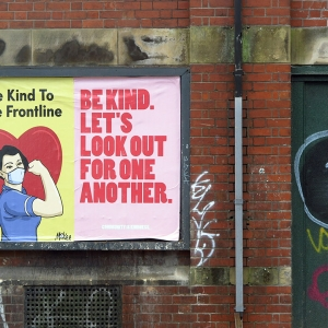 Board saying 'Be kind to the frontline'
