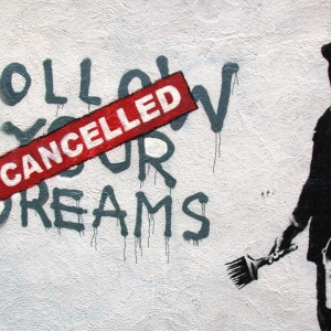 Street art of 'Follow your dreams - cancelled'