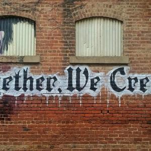 Street art saying 'Together we create'