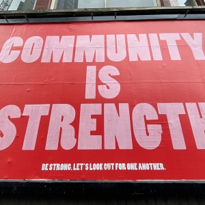 Billboard saying 'Community is strength'