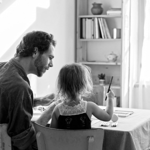 Father and daughter at table
