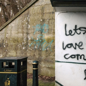 Graffiti saying 'Lets love our community'