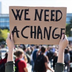 Sign saying 'We need a change'