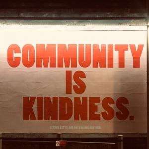 Billboard saying 'Community is kindness'