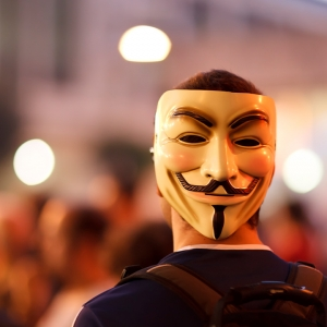 Guy wearing Guy Fawkes mask