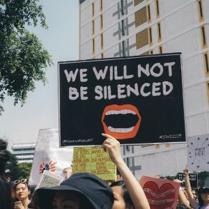 Protest sign saying 'We will not be silenced'