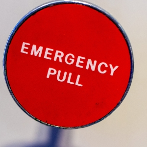 Red 'emergency pull' sign