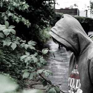 Teenager in hoodie on path