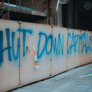Graffiti saying 'Shut down capitalism'