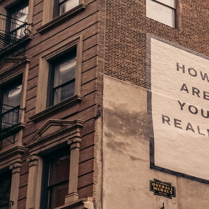 Sign on side of building saying how are you really