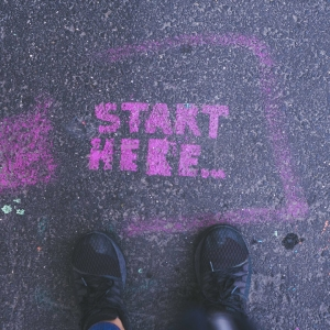 Floor graffiti saying 'Start here'