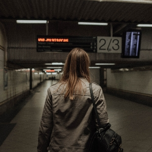 Woman walking in empty subway