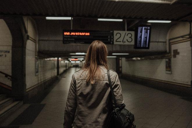 Woman walking in empty subway