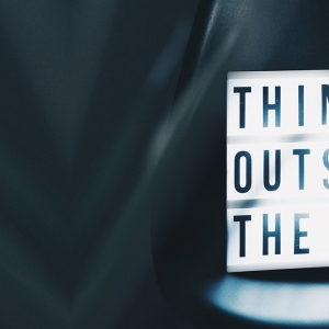 Sign saying 'Think outside the box'