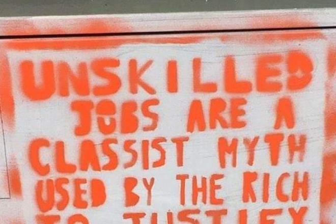 Graffiti saying 'unskilled jobs are a classist myth'