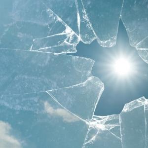 sun shining through a broken window