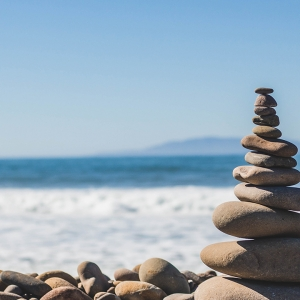 stacked pile of pebbles on a beach