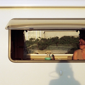 Woman in caravan window