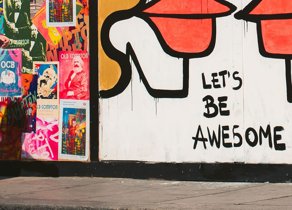 Graffiti saying 'Lets be awesome'
