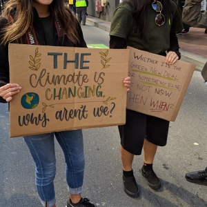 Sign saying 'The climate is changing, why aren't we?'