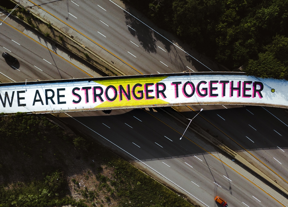 Graffiti saying 'We are stronger together'