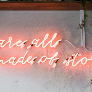 Neon sign saying 'We are all made of stories'