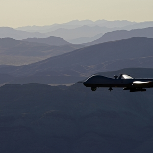 Reaper drone flying over hills