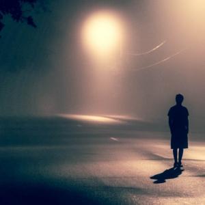 Person standing in a dark street