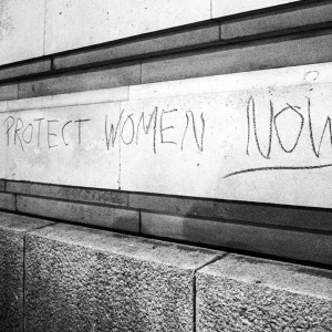 Writing on wall saying 'protect women now'