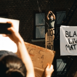 Sign saying 'Black Lives Matter' hung over balcony